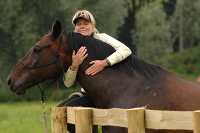 a hug doesn't mean much to the horse, but sure feels good.
